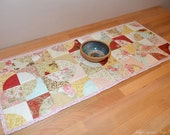 Quilted table runner, flower fabric table runner - modern, contemporary home decor.  Pastel table decor. Curved patchwork runner UK
