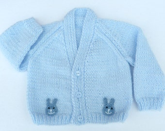 Baby sweater. Hand knitted pale blue baby cardigan to fit a  0 to 3 months baby. Baby clothes, baby gift, baby shower.