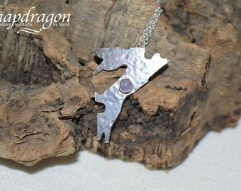 Sterling silver leaping hare pendant set with an amethyst cabochon