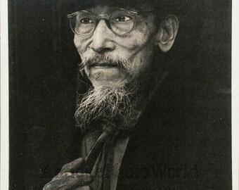 Old Asian man smoking pipe vintage art photo