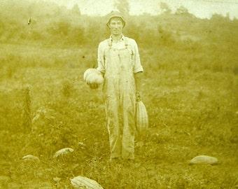 Vintage photograph photo farmer in pumpkin gourd field farming rustic primitive 1930's