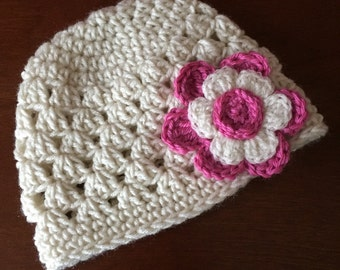 Baby beanie hat with flower crocheted in ivory with pink flower