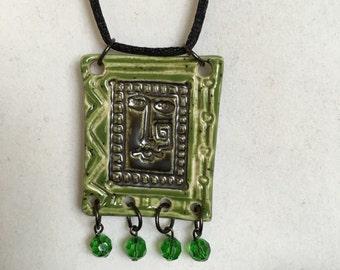 Green face pendant