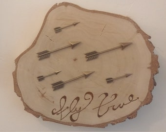 Birch wood round with arrows and wood burning.