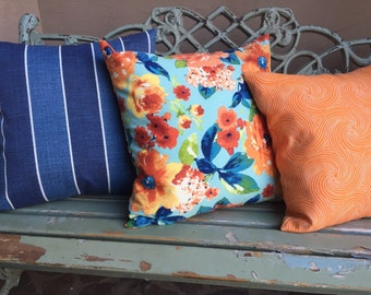 Outdoor pillow slipcovers- florals and stripes in indigo blues and oranges