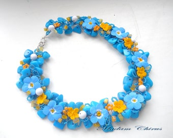 Elegant necklace made of natural stones with flowers