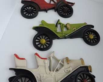 set of 3 vintage car wall plaques colorful cast metal lizzy wall decor office