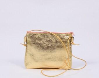 Stine - golden leather purse