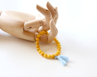 Yellow agata bracelet with light blue tassel