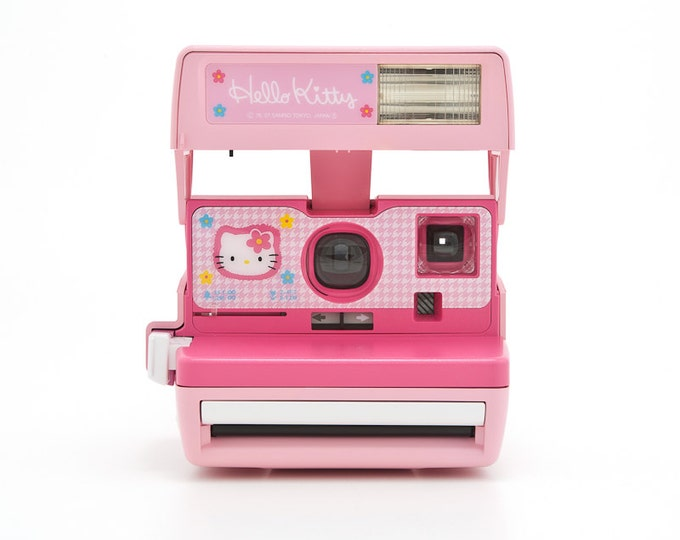Featured listing image: Polaroid Hello Kitty Instant Camera - Rare 90s Polaroid 600 - film tested and working - Sanrio - Made in the United Kingdom