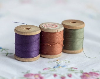 Orange, sage (pale) green and violet vintage sewing 100% pure cotton thread spools, set of three wooden spools with threads from 1980s