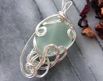 Sea Glass Pendant aqua sea glass with silver non tarnish silver wire. Free Style wire weaved and wire wrapped