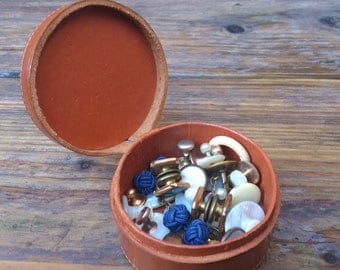 vintage leather stud box full of old cufflinks and shirt studs