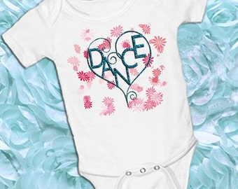 Dance in a heart, turquoise faux glitter and flowers in the background White onsie Snap bottom all in one bodysuit