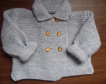 Hand knitted baby girls double breasted jacket