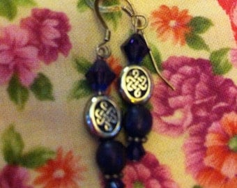 Purple and sterling silver pierced earrings with Celtic knot beads.