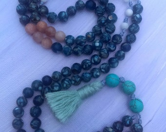 108 mala made of reconstituted shell, sunstone, and turquoise with sea foam green tassle