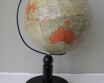 An English 6 inch terrestrial table globe on wooden stand, Philips, London, 1920