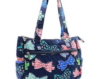 Quilted microfiber handbag, purse, multi purpose bag in navy with bow ties