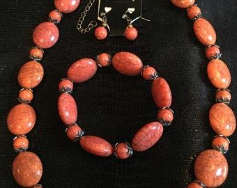 DBC  Orange Necklace, Earring and bracelet set.