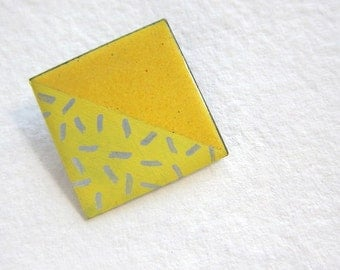yellow geometric brooch