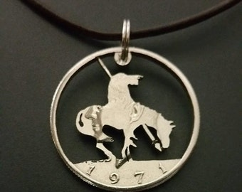 The End of the Trail pendant cut from a Kennedy half dollar coin jewelry