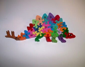 Child's Wooden Stegosaurus Dinosaur Alphabet Puzzle