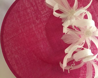 Pink fascinator with white feather flowers
