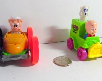 Pair of Warner Bros. fast food toys,  2 Whirlies.  Porky Pig.