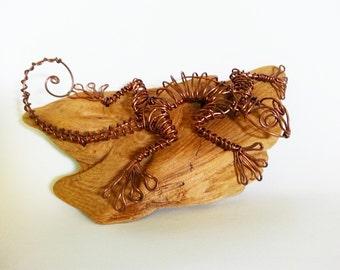 """Wire lizard """"gecko"""" sculpture on driftwood"""