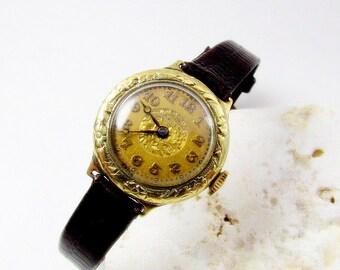 Vintage 14 kt Gold Gruen ladies Watch w Lizard Strap.