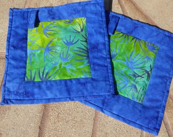 set of 2 Hot pads - 100% cotton outer fabric, bound together, top stitched with layer of insul-bright.  9 x 9 in size