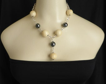 Haematite with Vegetable Ivory Globes