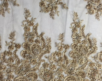 Metallic gold flowers embroider and heavy beaded on a mesh lace fabric-sold by the yard-