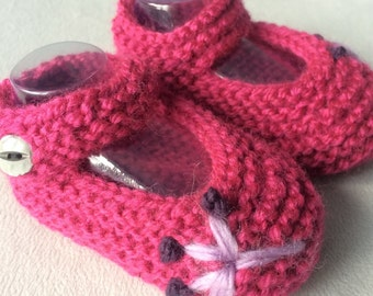 Pink baby booties with hand knitted flower, baby girl slippers