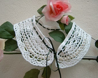 White lace collar made by hand crochet. Crochet fashion woman in romantic and feminine style. Cotton collar.