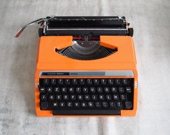 Silver Reed orange typewriter