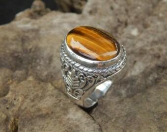 Silver ring patra motif with tiger eye stone