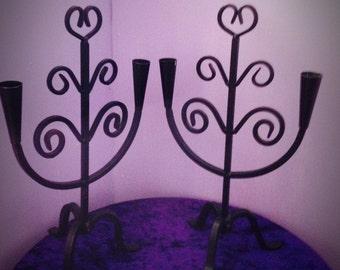 A set of vintage wrought iron candlesticks
