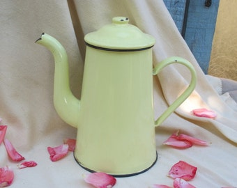 Old coffee maker in yellow enamel