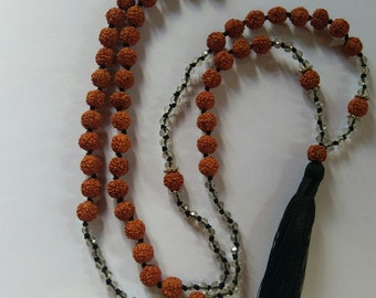 Handmade seed and stone bead with tassle necklace.