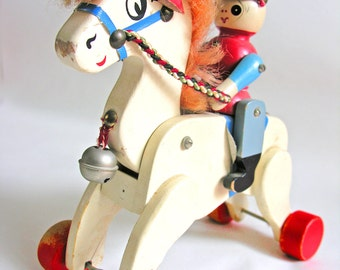 Vintage wooden pull-along horse with soldier. Made in China 1970
