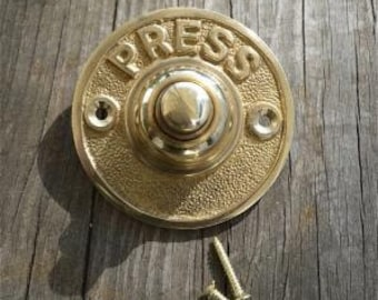A lovely solid brass antique style brass door bell