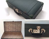 Vintage suitcase in army green with lovely purple seventies interior