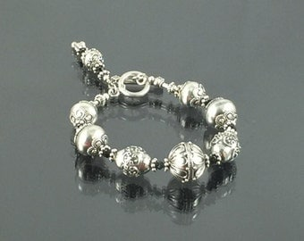 Sterling Silver Sphere Bracelet with Incredible Engravings