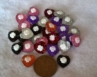 Pack Of 15 Flatback Hearts With White Flower In Centre Cabochons