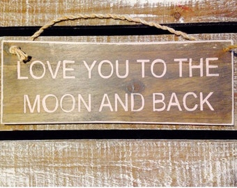 love you to the moon and back. wood sign.