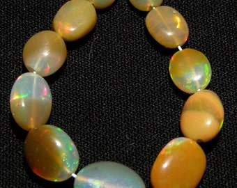 Natural Ethiopian Welo Opal Smooth Oval 5-7.5 M.M. 11 Pieces - Welo Opal Smooth Oval DM:- 7