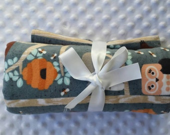 Forest animals baby blanket in blue, brown, pink, and cream with minky dot backing