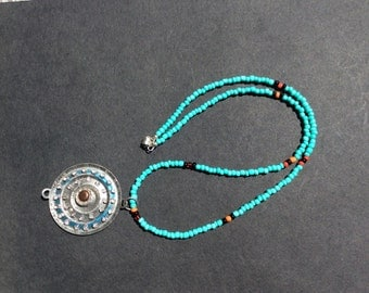 Turquoise colored seed beads